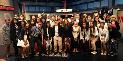 2017 Fellows on the set of Mad Money at CNBC