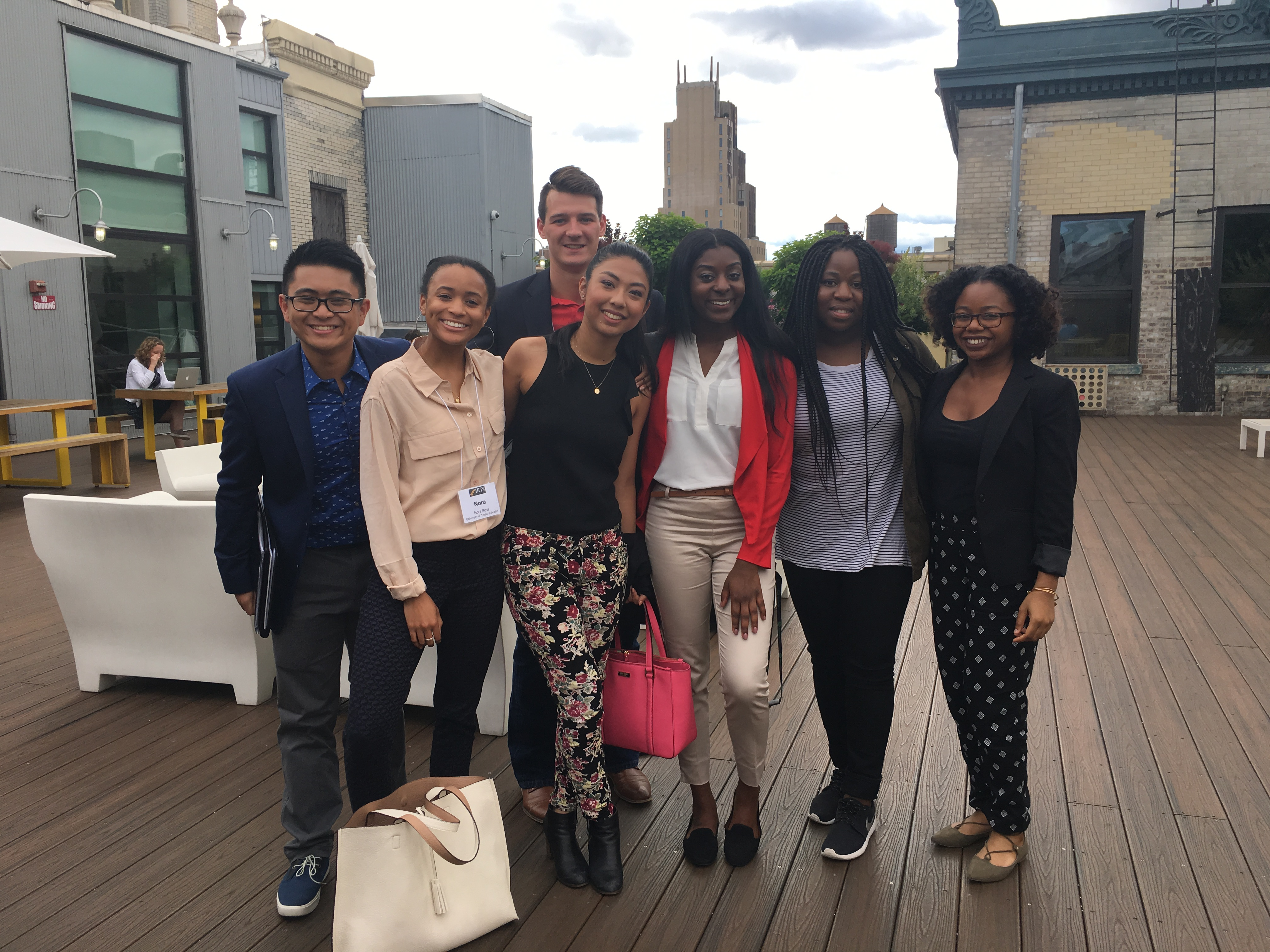 2017 IRTS Summer Fellows posing on the Spotify rooftop with 2013 IRTS alum, Tolu Ayeni