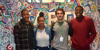 2016 IRTS Alumni & Facebook Employees Brian Robins, Mylan Jefferson, and Omar Wilson with 2017 IRTS alum Eric Uzick on a tour of Facebook's Austin office.