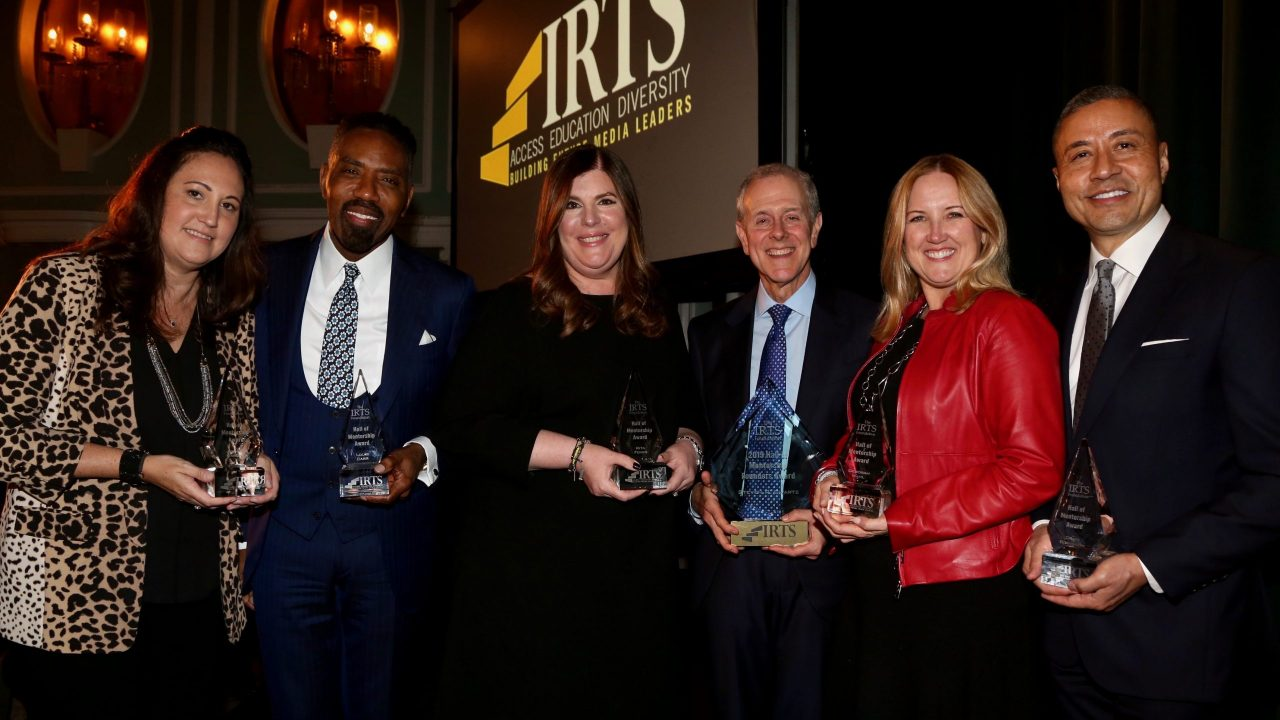 The honorees for the 2019 IRTS Hall of Mentorship standing together with their awards
